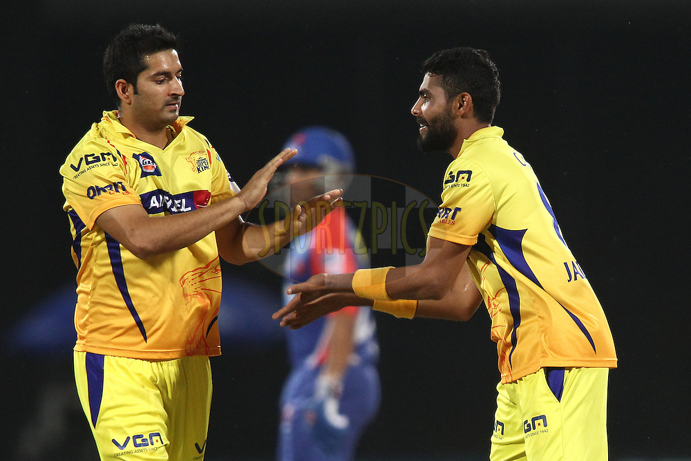 Mohit Sharma of The Chennai Super Kings congratulates Ravindra Jadeja of The Chennai Super Kings for getting Murali Vijay of the Delhi Daredevils wicket during match 26 of the Pepsi Indian Premier League Season 2014 between the Delhi Daredevils and the Chennai Super Kings held at the Feroze Shah Kotla cricket stadium, Delhi, India on the 5th May  2014<br /> <br /> Photo by Shaun Roy / IPL / SPORTZPICS<br /> <br /> <br /> <br /> Image use subject to terms and conditions which can be found here:  http://sportzpics.photoshelter.com/gallery/Pepsi-IPL-Image-terms-and-conditions/G00004VW1IVJ.gB0/C0000TScjhBM6ikg