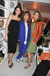 Left to right, Eva Karayiannis, Carmel Scott, and Kim Robson Ortiz at a party at De Roemer, 14 Porchester Place, London W2 on 1st May 2013.