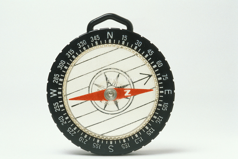 close up of compass pointing east