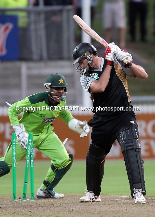Kyle Mills is stumped by Umar Akmal. New Zealand Black Caps v Pakistan, Match 2. Twenty 20 Cricket match at Seddon Park, Hamilton, New Zealand. Tuesday 28 December 2010. Photo: Andrew Cornaga/photosport.co.nz