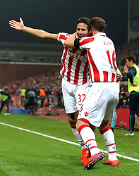 Ramadan Sobhi of Stoke City celebrates with Charlie Adam after scoring a goal although it is awarded as an own goal - Mandatory by-line: Robbie Stephenson/JMP - 31/10/2016 - FOOTBALL - Bet365 Stadium - Stoke-on-Trent, England - Stoke City v Swansea City - Premier League