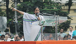 July 21, 2017 - Kolkata, WEST BENGAL, India - West Bengal Chief Minister and All India Trinamool Congress supremo Mamata Banerjee addressing her exclusive speech to the crowd which gathered on Martyr's Day in kolkata in India on July 21, 2017.Every year Mamata Banerjee conducts this rally in the remembrance of the 13 people killed by police on July 21, 1993 during protest rally against the then West Bengal government, led by the youth congress..West Bengal Chief Minister and All India Trinamool Congress supremo Mamata Banerjee addressing her exclusive speech to the crowd which gathered on Martyr's Day in kolkata in India on July 21, 2017.Every year Mamata Banerjee conducts this rally in the remembrance of the 13 people killed by police on July 21, 1993 during protest rally against the then West Bengal government, led by the youth congress. (Credit Image: © Sanjay Purkait/Pacific Press via ZUMA Wire)
