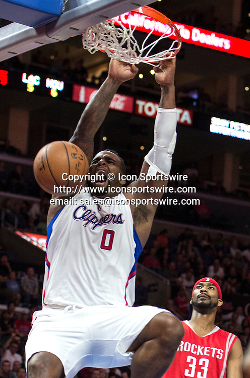 Feb. 11, 2015 - Los Angeles, CA, USA - Los Angeles Clippers' Glen Davis slams one down as Houston Rockets' Corey Brewer looks on during the first half at Staples Center in Los Angeles on Wednesday.