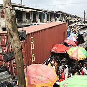 Electronic waste export to Nigeria...Alaba International Market, one of the largest markets for electronic goods in West Africa.  New and old - and a lot of non-working electronic goods such as TVs and computers come in to the market via Lagos harbour from the US, Western Europe and China. Containers full of goods being emptied...The shipment - TV-set originally delivered to municipality-run collecting point in UK for discarded electronic products - was tracked and monitored by Greenpeace using a combination of GPS (Global Positioning System using satellites), GSM (positioning using data from mobile networks to triangulate approximate positions) and an onboard radiofrequency transmitter (used for making triangulations in combination with handheld directional receivers used by team on ground) is placed inside the TV-set.  The TV arrived in Lagos in container no 4629416.