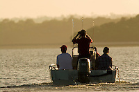 Tourists cruise the waters of the Archer River in search of Estuarine crocodiles which often bask on the banks of the waterways of the Aurukun Wetlands, remote Cape York, far northern Queensland, Australia.