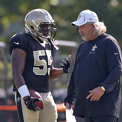 Jul 29, 2013; Metairie, LA, USA; New Orleans Saints defensive coordinator Rob Ryan talks with rookie linebacker Eric Martin (55) during a morning training camp practice at the team facility.  Mandatory Credit: Derick E. Hingle-USA TODAY Sports