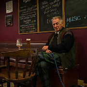 GLASGOW, SCOTLAND - MAY 15, 2017: Peter MacAskill, a relative of Giant Angus MacAskill, socialising at the only pub in Dunvegan, a small one street town in Isle of Skye. Mr. MacAskill runs a small museum in memory of his relative Angus MacAskill, at 7ft 9in foot tall giant that, according to the Guinness Book of World Records, is the tallest non-pathological giant in recorded history. CREDIT: Paulo Nunes dos Santos for The New York Times