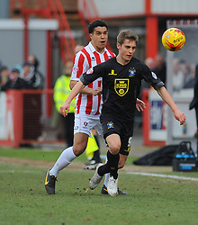 Cheltenham Town's Troy Brown jostles for possession against Bury's Danny Rose- Photo mandatory by-line: Nizaam Jones - Mobile: 07966 386802 - 14/02/2015 - SPORT - Football - Cheltenham - Whaddon Road - Cheltenham Town v Bury - Sky Bet League Two