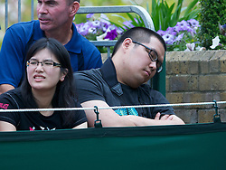 LONDON, ENGLAND - Monday, June 20, 2011: A spectator falls asleep during the Ladies' Singles 1st Round on day one of the Wimbledon Lawn Tennis Championships at the All England Lawn Tennis and Croquet Club. (Pic by David Rawcliffe/Propaganda)