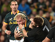 JOHANNESBURG, South Africa, 25 July 2015 : Richie McCaw (C) of the All Blacks is handed off by Schalk Burger (C) of the Springboks during the Castle Lager Rugby Championship test match between SOUTH AFRICA and NEW ZEALAND at Emirates Airline Park in Johannesburg, South Africa on 25 July 2015. Bokke 20 - 27 All Blacks<br /> <br /> © Anton de Villiers / SASPA