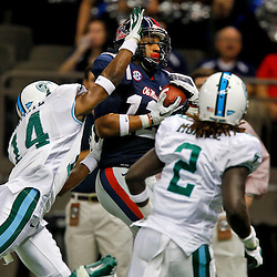 September 22, 2012; New Orleans, LA, USA; Ole Miss Rebels wide receiver Donte Moncrief (12) catches a touchdown over Tulane Green Wave cornerback Jordan Batiste (14) during the first quarter of a game at the Mercedes-Benz Superdome.  Mandatory Credit: Derick E. Hingle-US PRESSWIRE