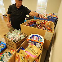 Mike Pettigrew sorts the different items as the American Legion Post 49 in Tupelo gets ready to build 4,000 care packages for the members of the 155th Brigade Combat Team.