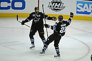 May 26, 2013; San Jose, CA, USA; San Jose Sharks left wing T.J. Galiardi (21) is congratulated by center Joe Thornton (19) for scoring a goal against the Los Angeles Kings during the second period in game six of the second round of the 2013 Stanley Cup Playoffs at HP Pavilion.