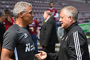 Northampton Town manager Keith Curle  chats to Sheffield United manager Chris Wilder during the Pre-Season Friendly match between Northampton Town and Sheffield United at the PTS Academy Stadium, Northampton, England on 20 July 2019.