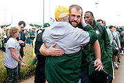 Judge Ken Starr, President and Chancellor of Baylor University, hugs Baylor Bears defensive lineman Beau Blackshear as the team exits the bus before defeating #9 TCU in Waco, Texas on October 11, 2014. (Cooper Neill for The New York Times)