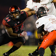 10 November 2018: San Diego State Aztecs linebacker Kyahva Tezino (44) breaks into the backfield to tackle UNLV Rebels running back Lexington Thomas (3) in the third quarter. The Aztecs lost 27-24 to UNLV Saturday night at SDCCU Stadium falling a game behind Fresno State in the conference standings.