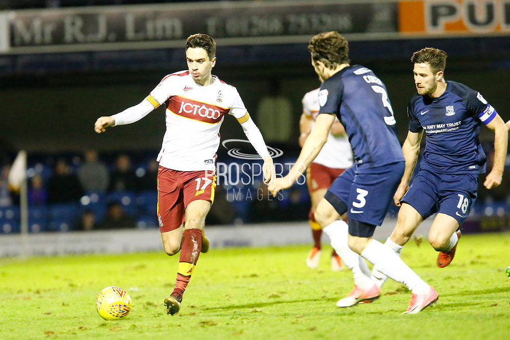 Bradford's midfielder Alex Gilliead makes a break shadowed by Southend's defender Ben Coker and Southend's defender Ryan Leonard during the EFL Sky Bet League 1 match between Southend United and Bradford City at Roots Hall, Southend, England on 16 December 2017. Photo by Matt Bristow.