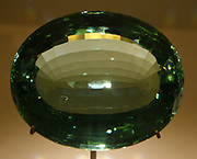 Rain in sea water. Beryl, variety aquamarine, 898 carats,  Russia, 1868. Named after the Greek for sea water, aquamarine comes in a range of colours from light blue to vibrant turquoise.  If you look closely, you can see, within this beautifully cut stone small parallel lines known as rain, which are actually narrow fluid-filled tubes.