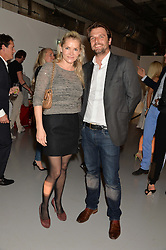 CHRISTINA KNUDSEN and RICHARD STEELE at the Audemars Piguet Royal Oak Offshore 42mm Party held at Victoria House, Bloomsbury Square, London on 23rd April 2014.