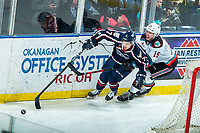 KELOWNA, BC - FEBRUARY 12: Dallon Wilton #15 of the Kelowna Rockets stick checks Luke Zazula #7 of the Tri-City Americans as they skate for the puck behind the net in third period at Prospera Place on February 8, 2020 in Kelowna, Canada. (Photo by Marissa Baecker/Shoot the Breeze)