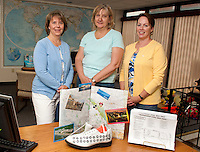 "Anne Cote, Marie Caprario and Kim Terrio of Penny Pitou Travel display their ""cruise shoe"" creation made by Sandy Percy during the Downtown Still Has Sole event which will be ongoing through Thursday.  (Karen Bobotas/for the Laconia Daily Sun)"