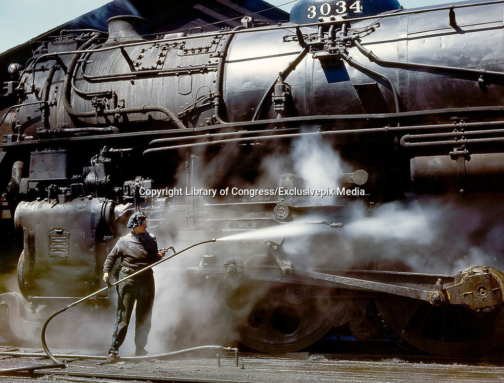 """Fascinating Color Portrait Photos of Women Railroad Workers During WWII<br /> <br /> World War II began when Hitler's army invaded Poland on September 1, 1939. However, it wasn't until the day after the Japanese attacked Pearl Harbor on December 7, 1941, that the United States declared war on the Axis Powers.<br /> <br /> The railroads immediately were called upon to transport troops and equipment heading overseas. Soon the efforts increased to supporting war efforts on two fronts-- in Europe and in the Pacific.<br /> <br /> Prior to the 1940s, the few women employed by the railroads were either advertising models, or were responsible primarily for cleaning and clerical work. Thanks to the war, the number of female railroad employees rose rapidly. By 1945, some 116,000 women were working on railroads. A report that appeared on the 1943 pages of Click Magazine regarding the large number of American women who had stepped forward to see to it that the American railroads continued to deliver the goods during the Second World War:<br /> <br />     """"Nearly 100,000 women, from messengers aged 16 to seasoned railroaders of 55 to 65, are keeping America's wartime trains rolling. So well do they handle their jobs that the railroad companies, once opposed to hiring any women, are adding others as fast as they can get them...""""<br /> <br /> In April 1943, Office of War Information photographer Jack Delano photographed the women of the Chicago & North Western Railroad roundhouse in Clinton, Iowa, as they kept the hulking engines cleaned, lubricated and ready to support the war effort.<br /> <br /> Photo shows: Mrs. Viola Sievers sprays an H-class locomotive with steam.<br /> ©Library of Congress/Exclusivepix Media"""