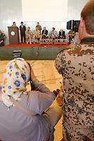 11 AUG 2003, KABUL/AFGANISTAN:<br /> Eine Fotografin mit Kopftuch, offenbar aus Kabul, und ein Bundeswehrsoldat, fotografieren die Pressekonferenz nach dem Appell zur Uebergabe der Fuerhrung der International Security Assistance Force, ISAF, von Deutschland und den Niederlanden an die NATO, Armani Schule<br /> IMAGE: 20030811-01-053<br /> KEYWORDS: Emanzipation, Gleichberechtigung, Frau, Islam,