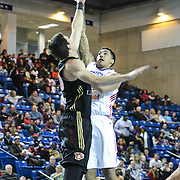 Delaware 87ers Forward Drew Gordon (32) drives towards the basket as Erie BayHawks Forward Daniel Coursey (30) defends in the first half of a NBA D-league regular season basketball game between the Delaware 87ers and the Erie BayHawk (Orlando magic) Friday, Jan. 02, 2015 at The Bob Carpenter Sports Convocation Center in Newark, DEL