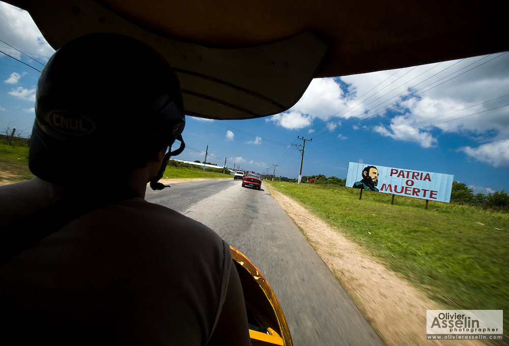 View from inside a coco-taxi along the road from Trinidad to Ancon, Cuba on Wednesday July 16, 2008.
