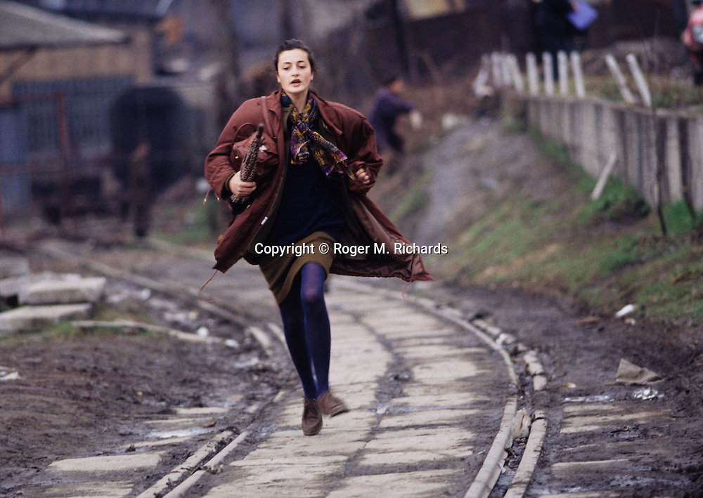 Sanda Skrabić runs to avoid being shot by a Serb sniper during the siege of Sarajevo, Bosnia and Herzegovina, April 1993.