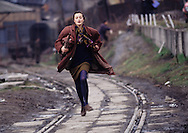 A young woman runs to avoid being shot by a Serb sniper during the siege of the city, Sarajevo, Bosnia and Herzegovina, April 1993.