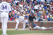 CHICAGO, IL - JUNE 25: Jimmy Rollins #11 of the Los Angeles Dodgers gets tagged out at third base by Kris Bryant #17 of the Chicago Cubs during the game at Wrigley Field on June 25, 2015 in Chicago, Illinois. The Dodgers defeated the Cubs 4-0. (Photo by Joe Robbins) *** Local Caption *** Jimmy Rollins;Kris Bryant