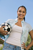 Young Woman Holding Soccer Ball