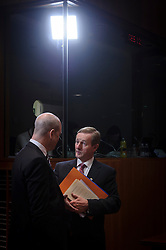 Enda Kenny, Ireland's prime minister, right, speaks with Fredrik Reinfeldt, Sweden's prime minister, on the first day of the EU Summit, at the European Council headquarters in Brussels, Belgium on Thursday, Dec. 13, 2012. (Photo © Jock Fistick)