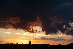 ©Licensed to London News Pictures 03/08/2020     Orpington, UK. The setting sun over South East London this evening. More hot weather is on the way as forecasters predict temperatures will hit 36C later this week. Photo credit: Grant Falvey/LNP