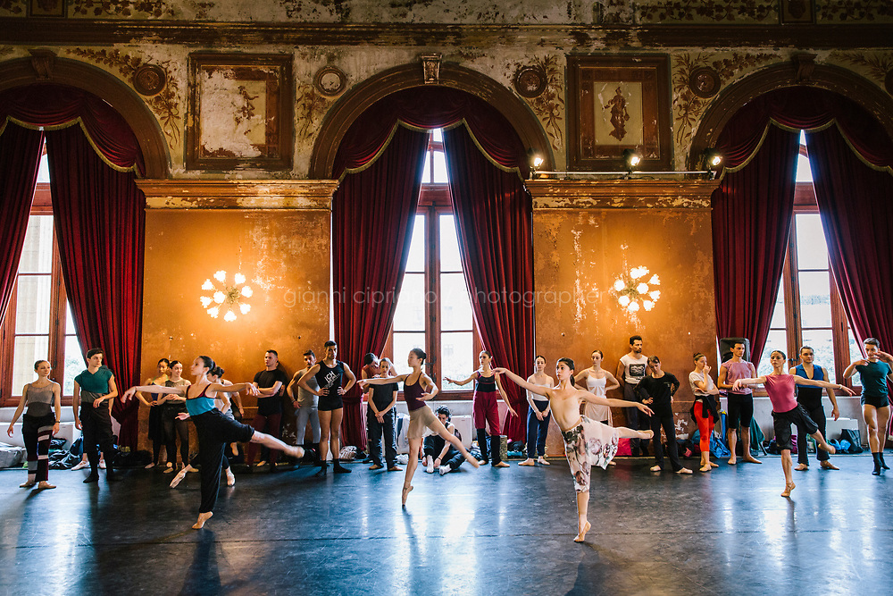 PALERMO, ITALY - 18 FEBRUARY 2018: The Corps de Ballet of the Teatro Massimo rehearses in the Sala degli Stemmi (Coat of Arms room) of the Teatro Massimo shortly before the dress rehearsal of the Don Quixote in Palermo, Italy, on February 18th 2018.<br /> <br /> The Teatro Massimo Vittorio Emanuele is an opera house and opera company located  in Palermo, Sicily. It was dedicated to King Victor Emanuel II. It is the biggest in Italy, and one of the largest of Europe (the third after the Op&eacute;ra National de Paris and the K. K. Hof-Opernhaus in Vienna), renowned for its perfect acoustics. It was inaugurated in 1897.