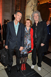 "Left to right, DENIS PELLERIN, MICHELINE PELLERIN and BRIAN MAY at a private view of Undressed: A Brief History Of Underwear"" at the V&A, London on 13th April 2016."