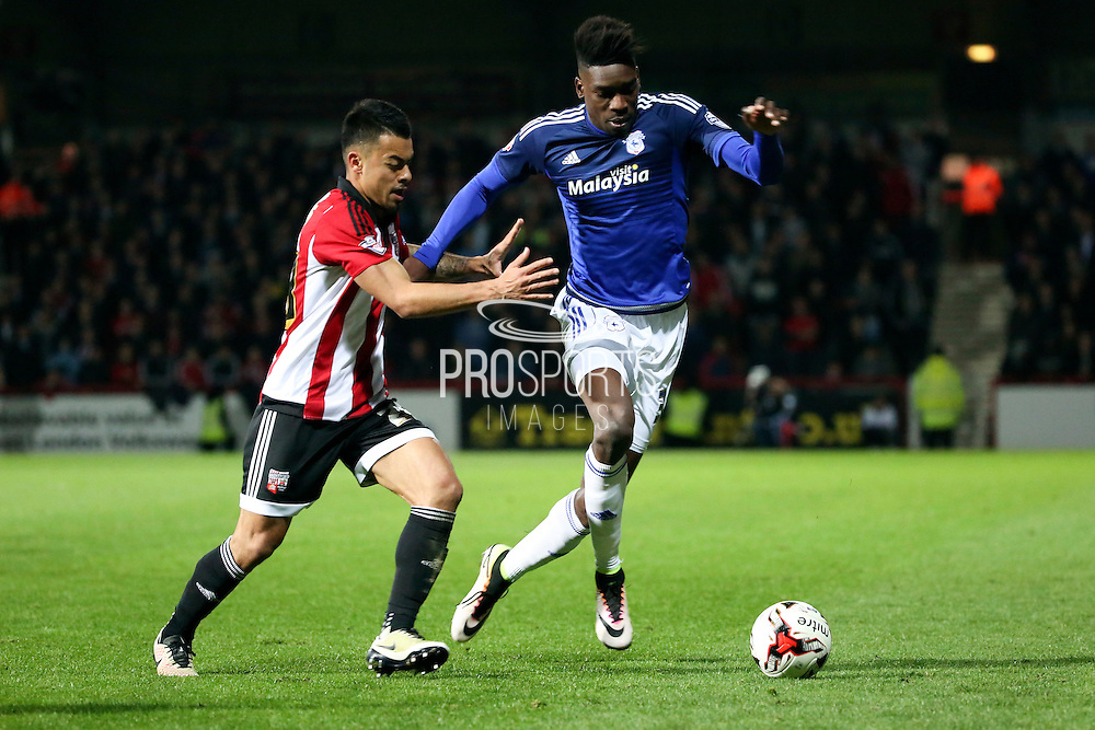 Cardiff City midfielder, Sammy Ameobi (38) battling with Brentford defender, Nico Yennaris (28) during the Sky Bet Championship match between Brentford and Cardiff City at Griffin Park, London, England on 19 April 2016. Photo by Matthew Redman.