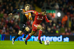 LIVERPOOL, ENGLAND - Wednesday, December 15, 2010: Liverpool's Ryan Babel and FC Utrecht's captain Michael Silberbauer during the UEFA Europa League Group K match at Anfield. (Photo by: David Rawcliffe/Propaganda)
