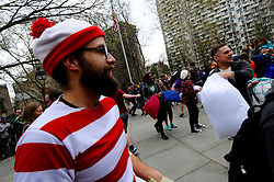 Event organizer CALEB DERBY, of Phila, sees how hundreds gather for an April 2, 2016 Pillow Fight at Washington Sqaure Park in Center City Philadelphia, PA.