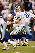 IRVING, TX - JANUARY 13:   Tony Romo #9 of the Dallas Cowboys scrambles away from the defensive rush against the New York Giants during the NFC Divisional playoff at Texas Stadium on January 13, 2008 in Dallas, Texas.  The Giants defeated the Cowboys 21-17.  (Photo by Wesley Hitt/Getty Images) *** Local Caption *** Tony Romo