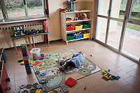 Sesta Godano, Italy - 14 January, 2013:  A boy plays in the multigrade classroom of the elementary school of Sesta Godano, Italy, on 14 January, 2013. <br /> <br /> Sesta Godano is a town in the province of La Spezia, in the Liguria region, with a population of about 1,400.  Because of a low number of children in the area, students in the elementary and seconday have been grouped in multigrade classes. According to the ISTAT (Italian National Statistical Institute) Liguria is the oldest of the Italian regions, with the highes ageing index of 232 percent compared to the national average of 144,5 percent and the EU average of 111,3 percent (data is from 2010). In Liguria there are almost twie as much deaths than births. The average age in Liguria is 48 years old. <br /> <br /> Italy is ageing. According to ISTAT, the average age will rise from 43.5 in 2011 to a maximum of 49.8 in 2059.