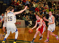 Laconia's Natalie Compton brings the ball through Gilford defenders during the girls finals Thursday evening at the 42nd annual Holiday Basketball Tournament.  (Karen Bobotas/for the Laconia Daily Sun)