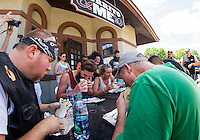 "Alex Cancel and Jenna Russell have a quick bite at Burrito Me in Veteran's Square during their annual ""burrito eating"" contest on Thursday afternoon.  (Karen Bobotas/for the Laconia Daily Sun)"