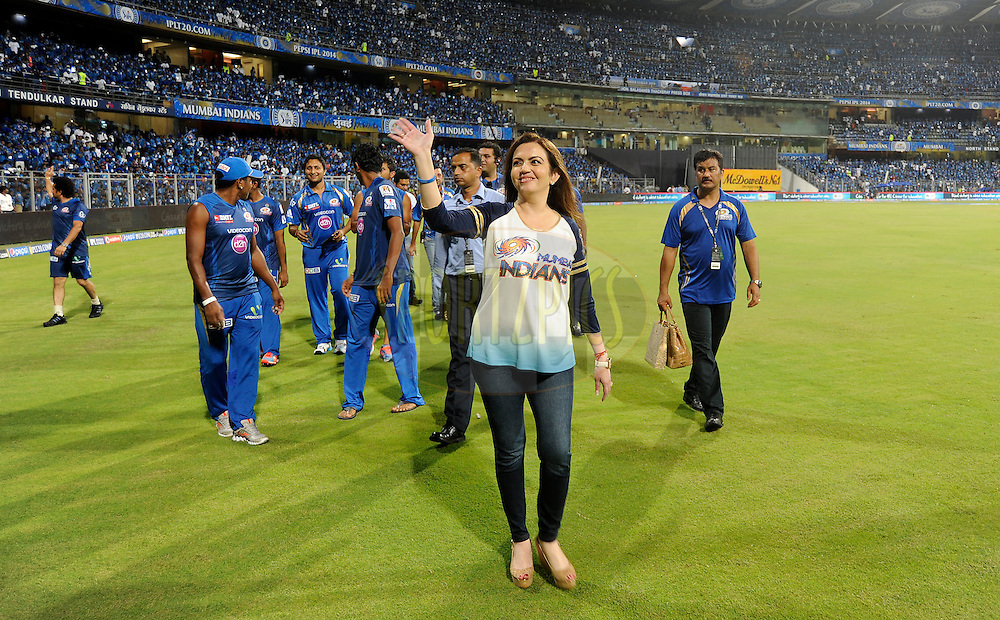 Nita Ambani owner of the Mumbai Indians waves at the Under Privilege children as she takes a lap of the ground with the team after match 22 of the Pepsi Indian Premier League Season 2014 between the Mumbai Indians and the Kings XI Punjab held at the Wankhede Cricket Stadium, Mumbai, India on the 3rd May  2014<br /> <br /> Photo by Pal Pillai / IPL / SPORTZPICS<br /> <br /> <br /> <br /> Image use subject to terms and conditions which can be found here:  http://sportzpics.photoshelter.com/gallery/Pepsi-IPL-Image-terms-and-conditions/G00004VW1IVJ.gB0/C0000TScjhBM6ikg