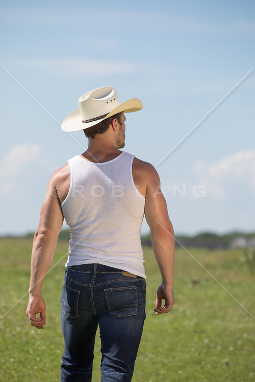 hot cowboy walking off towards the horizon