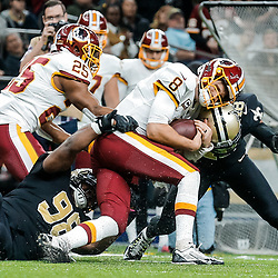 Nov 19, 2017; New Orleans, LA, USA; New Orleans Saints safety Vonn Bell (48) and defensive tackle Sheldon Rankins (98) tackle Washington Redskins quarterback Kirk Cousins (8) during the second half of a game at the Mercedes-Benz Superdome. The Saints defeated the Redskins 34-31 in overtime. Mandatory Credit: Derick E. Hingle-USA TODAY Sports