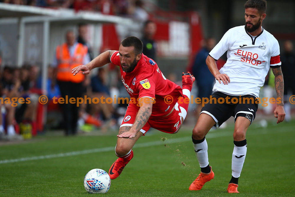 Crawley's Ollie Palmer is brought down during the pre season friendly between Crawley Town and KSV Roeselare at The Broadfield Stadium, Crawley , UK. 28 July 2018.