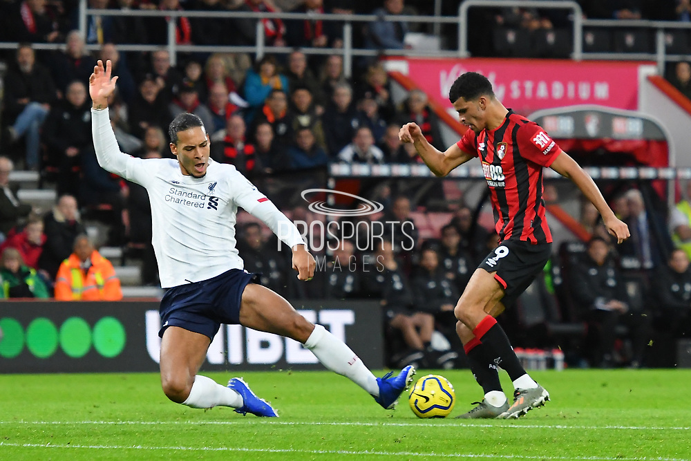 Virgil van Dijk (4) of Liverpool tackles Dominic Solanke (9) of AFC Bournemouth to stop a shot at goal during the Premier League match between Bournemouth and Liverpool at the Vitality Stadium, Bournemouth, England on 7 December 2019.