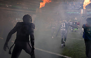 Dec 24, 2017; East Rutherford, NJ, USA; New York Jets strong safety Jamal Adams (33) and cornerback Derrick Jones (31) enter the field through a tunnel of fire and smoke during an NFL football game against the Los Angeles Chargers at MetLife Stadium. The Chargers defeated the Jets 14-7.